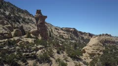 Aerial rock tower near Swasey Cabin San Rafael Utah landscape. Utah State Register of Historic Sites built in 1921, but the wild west Swasey Boys. Cattle ranch in the southern desert of Utah in the San Rafael Swell. Off road 4x4 recreation and wilderness area. Dry arid landscape. Towering sandstone towers, pinnacles, mountains and cliffs. Beautiful natural nature environment. Recreation exploration and vacation destination. 4K HD video footage. Despain Rekindle Photo. 191
