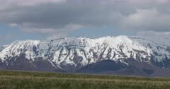 Mount Nebo Utah spring snow mountain clouds fast motion. Wasatch Mountain range fast moving clouds on horizon of pine forest. Beautiful nature landscape. Uinta National Forest and wilderness area. Fast time lapse. DCI 4K video footage. Despain Rekindle Photo. 1017