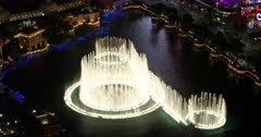 Las Vegas Strip dark night dancing water fountain time lapse. Famous Las Vegas Strip attraction, tourism and tourist admire musical dancing fountain along the road. Choreographed water features, light and jets. Runs day and night. Colorful lights and smoke make a spectacular presentation show. Bellagio resort luxury destination. Adult centered with gambling, party and alcohol. Leading destination for conventions, business, and meetings. Sin City. 4K HD video footage. Despain Rekindle Photo. 1108