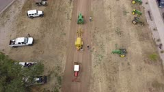 Aerial antique tractor pull demonstration overhead rural. Rural farming community is agriculture based economy. Old and historic tractors in use on farms. City celebration competition and demonstration of the industrial strength and power of old diesel power machines. 4K HD video footage. Despain Rekindle Photo. 035