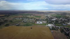 Aerial Monticello Utah rural city pan. Rural community southern Utah, San Juan County. High mountain plateau, dry farm landscape. Remote agriculture economy. Homes, fields and small town business. 4K HD video footage. Despain Rekindle Photo. 012