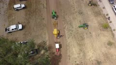 Aerial overhead antique tractor pull demonstration. Rural farming community is agriculture based economy. Old and historic tractors in use on farms. City celebration competition and demonstration of the industrial strength and power of old diesel power machines. 4K HD video footage. Despain Rekindle Photo. 034