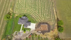 Aerial rural farm house alfalfa field drone flight. Aerial rural farming community agricultural economy. Spring summer weather mountain valley green agriculture field. Seasonal rural farm city. Homes, barns and buildings. Drone flight. 4K HD video footage. Despain Rekindle Photo. 033