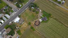 Aerial rural town farm house fields new construction. Aerial rural farming community agricultural economy. Spring summer weather mountain valley green agriculture field. Seasonal rural farm city. Homes, barns and buildings. Drone flight. 4K HD video footage. Despain Rekindle Photo. 019