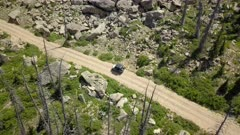 Aerial 4x4 offroad ATV recreation drive forest mountain road. Skyline Drive off road trail and road central Utah. Alpine peaks, meadows and valley forest. Travel and exploring wilderness outback country landscape and nature. 4K HD video footage. Despain Rekindle Photo. 028