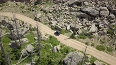 Aerial 4x4 offroad ATV recreation forest mountain road fast. Skyline Drive off road trail and road central Utah. Alpine peaks, meadows and valley forest. Travel and exploring wilderness outback country landscape and nature. 4K HD video footage. Despain Rekindle Photo. 028