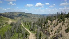 Aerial high mountain trail central Utah forest. Skyline Drive off road trail and road central Utah. Alpine peaks, meadows and valley forest. Travel and exploring wilderness outback country landscape and nature. 4K HD video footage. Despain Rekindle Photo. 037