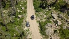 Aerial off road 4x4 high mountain trail recreation. Skyline Drive off road trail and road central Utah. Alpine peaks, meadows and valley forest. Travel and exploring wilderness outback country landscape and nature. 4K HD video footage. Despain Rekindle Photo. 024