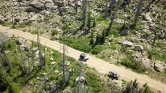 Aerial off road 4x4 recreation ATV mountain trail road. Skyline Drive off road trail and road central Utah. Alpine peaks, meadows and valley forest. Travel and exploring wilderness outback country landscape and nature. 4K HD video footage. Despain Rekindle Photo. 026