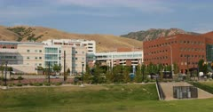 Salt Lake City University of Utah hospital building pan. Research and teaching hospital on the campus in Salt Lake City, Utah. Specialties, cardiology, geriatrics, gynecology, pediatrics, pulmonology, neurology, oncology, orthopedics, and ophthalmology. Medical complex University and Primary Children's Hospitals, Moran Eye Center, Huntsman Cancer Institute, Dental School, clinics and Diabetes Center. Doctors Residents save lives. 4K HD video footage. Despain Rekindle Photo. 5711