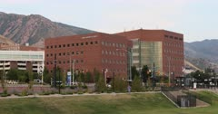 University of Utah hospitals Moran Eye Center. Research and teaching hospital on the campus in Salt Lake City, Utah. Specialties, cardiology, geriatrics, gynecology, pediatrics, pulmonology, neurology, oncology, orthopedics, and ophthalmology. Medical complex University and Primary Children's Hospitals, Moran Eye Center, Huntsman Cancer Institute, Dental School, clinics and Diabetes Center. Doctors Residents save lives. 4K HD video footage. Despain Rekindle Photo. 5769