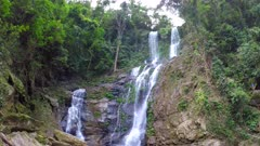 High waterfall in the rainforest on the island of Mindoro in Philippines