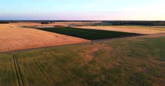 Aerial view over farmland during sunset