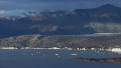 Series of UHD air to air aerials of swans migrating past alaska forest and glaciers
