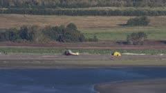 Airplane parked alongside a coastal river in Katmai National Park,Alaska