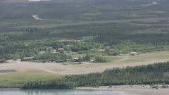 Aerial shot of a dirt airstrip in the remote city of Bettles, Interior Alaska