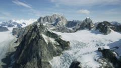 Aerial shot of rugged mountains and Ruth glacier in Denali National Park, Alaska