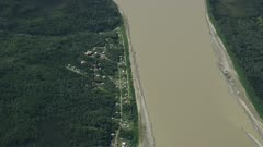 Aerial shot of a small village along the Yukon River during summertime in Alaska