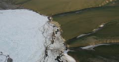 Aerial of a Porcupine Caribou herd crossing a frozen river in the Arctic National Wildlife Refuge 1002 area