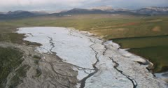 Aerial shot of an Alaskan river frozen and covered with snow in the Arctic National Wildlife Refuge