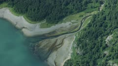 Scenic aerial of a river meeting the ocean at Glacier Bay National Park and Preserve