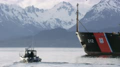 Small boats traveling through the Homer Boat Harbor, Alaska