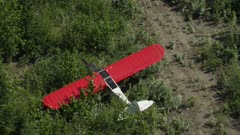 Aerial of a wrecked Piper PA-18 Super Cub Airplane lying in bushes