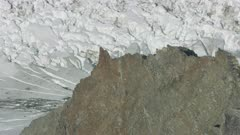 Aerial shot of a glacier in the snowy Tordrillo Mountains in Southcentral Alaska