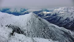 UHD Tilt up reveal rugged snow covered mountains in Brooks Range Northern Alaska Arctic