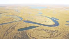 Aerial of a river winding through the North Slope tundra and wetland lakes