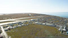 Landing a helicopter at an airfield in the village of Barrow, Alaska
