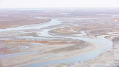 River winding through the North Slope wetland tundra