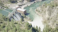 UHD 8k aerial of small hydro electic powerplant dam on river in easter oregon or idaho