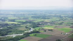 UHD Aerial of Northern Washington valley with green farms and river