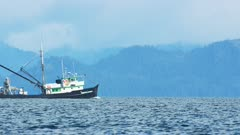 UHD footage of Fishing boat traveling in Prince William sound Alaska on gray moody day