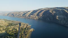 UHD aerial of barge with wood products on the columbia river gorge