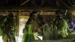 slow motion rare footage of Tribal Warriors   dancing at the sound of Sacred Flutes, inside Mans house.