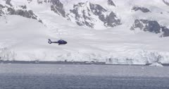 Helicopter landing on Superyacht 'Planet 9' in Antarctic.