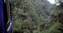 Helicopter flying in narrow mountain canyon, Rwenzori Mountains, Ruwenzori Range, Uganda.