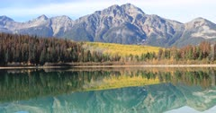 Golden aspens reflected in the Rocky Mountains 4K