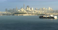San Francisco skyline with container ship in front 4K