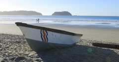 Beach scene in Costa Rica with boat in foreground 4K