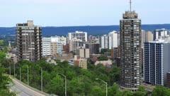 Timelapse of Hamilton, Canada expressway with skyline behind 4K