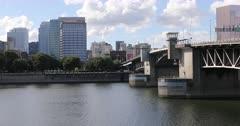 Portland, Oregon skyline by bridge over Willamette River 4K