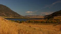 Grass Lands surrounding lake mountains on both sides - semi-arid