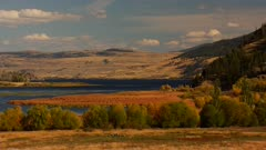 Grass Lands surrounding lake mountains on both sides - semi-arid  - Tighter Shot