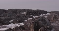4K Polar Bear mother and cub walk down rock, cub cuddles mother, slow motion - SLOG2 Not Colour Corrected