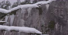4K Icicles along rock face in the snow, pan - SLOG2 Not Colour Corrected