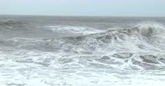 Large Waves Sweep Ashore Onto Rocky Coastline