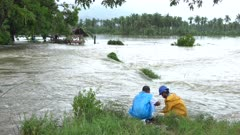 River Flood Overflows Onto Farmland After Heavy Rain
